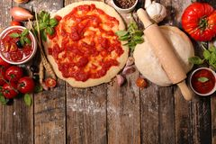 Raw dough pizza. And ingredient Royalty Free Stock Photo