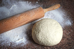 Raw dough with rolling pin Stock Photos