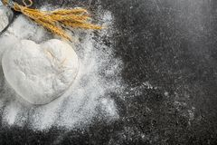 Raw dough sprinkled with flour. On table Stock Photo