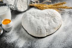 Raw dough sprinkled with flour. On table Royalty Free Stock Photography