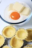Raw dough in tartlet pans Stock Photos
