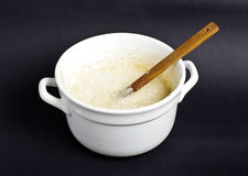 Raw dough in the white pot Royalty Free Stock Images