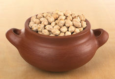 Raw Dried Chickpeas in Rustic Bowl Royalty Free Stock Photos