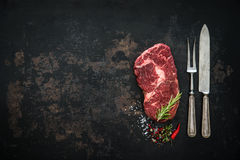 Raw dry aged beef ribeye steak. On dark background Royalty Free Stock Photos