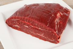 Raw dry aged flank steak. A piece of raw dry aged flank steak royalty free stock photography