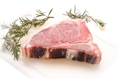 Raw dry aged steak with bones royalty free stock photos