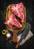 Raw dry aged t-bone steaks for grill Royalty Free Stock Photography