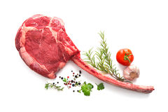 Raw dry aged tomahawk steak. Isolated on white Royalty Free Stock Photography