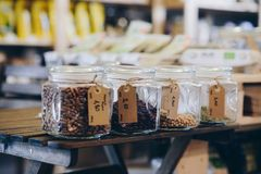 Raw dry bean grains in glass jars in the eco shop. Healthy diet food Stock Photography