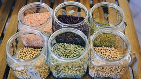 Raw dry bean grains in glass jars in the eco shop. Healthy diet food Stock Image