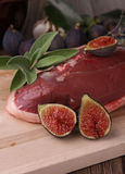 Raw duck breast and figs Royalty Free Stock Image