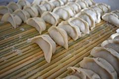 Raw dumpling on bamboo wickerwork Royalty Free Stock Images