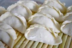 Raw dumpling on bamboo wickerwork Royalty Free Stock Photos