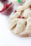 Raw dumplings with cranberries on a wooden board Stock Image