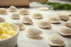 Raw dumplings on grey table, closeup. Process of cooking stock photo