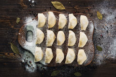 Raw dumplings with potato on board Royalty Free Stock Photos