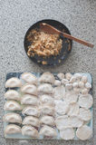 Raw dumplings and their stuffing Royalty Free Stock Image