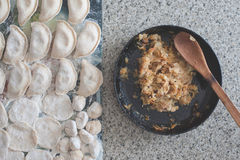 Raw dumplings and their stuffing Royalty Free Stock Images