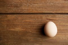 Raw egg on background. Raw egg on wooden background Royalty Free Stock Photos