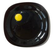 Raw egg on a black plate Stock Photos