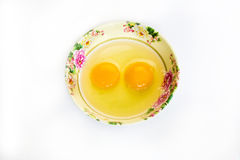 Raw egg in cup Stock Photos