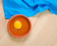 Raw egg in a dish Stock Photography