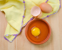 Raw egg in a dish Stock Images