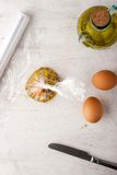 Raw egg  with herbs in the transparent bag Royalty Free Stock Image