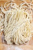 Raw egg noodles. And flour Royalty Free Stock Images