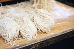 Raw egg noodles. And flour Stock Photo