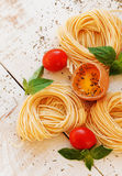 Raw egg and noodles with spices Stock Images