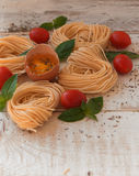 Raw egg and noodles with spices Stock Photo