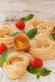 Raw egg and noodles with spices Royalty Free Stock Photography