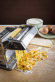 Raw egg pasta with flour and rolling pin Stock Images
