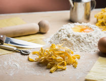 Raw egg pasta with flour and rolling pin Stock Photos