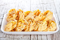 Raw egg pasta in a plate Stock Photo