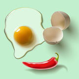 Raw egg and pepper Stock Photos