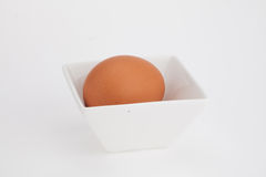 Raw egg in porcelain Stock Photo