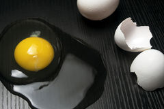 Raw egg and shells Stock Photo