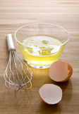 Raw egg whites. Just cracked into a glass bowl waiting to be whisked Royalty Free Stock Photo