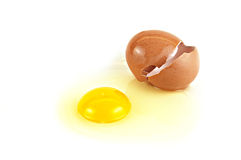 Raw Egg With Brown Shell On White Background Stock Photos