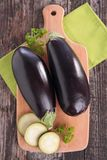 Raw eggplant on board Stock Image