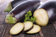 Raw eggplant on board. Fresh raw eggplant on board Stock Image