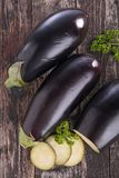 Raw eggplant on board Stock Photo