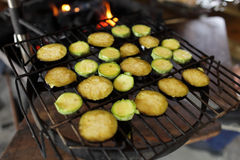 Raw eggplant on the grill Royalty Free Stock Photography