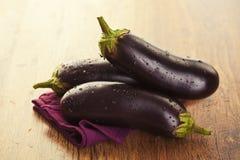 Raw eggplants Stock Photos