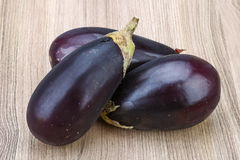 Raw eggplants. Fresh Ripe Raw eggplants on the wood background Stock Photography