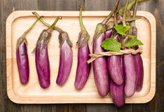 Raw eggplants. On wooden background Royalty Free Stock Image
