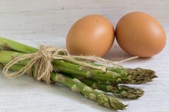 Raw eggs and asparagus, healthy breakfast, ingredients for cooking royalty free stock photos