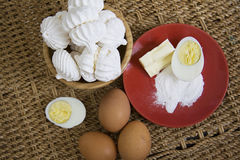 Raw eggs and baked meringues Stock Photos
